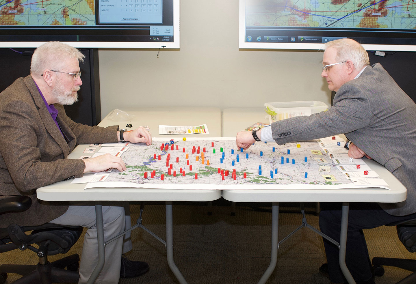 "Mike Dunn, left, and Dr. James Sterrett, demo a friendly game of ""Fluvius Bellum,"" a wargame created by Chris Carnes."