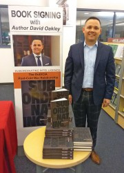 "Lt. Col. David Oakley, an assistant professor at the National Defense University and author of ""Subordinating Intelligence: The CIA/DoD Post-Cold War Relationship,"" takes time for a photo in the AAFES Bookstore in the Lewis and Clark Center on April 17."