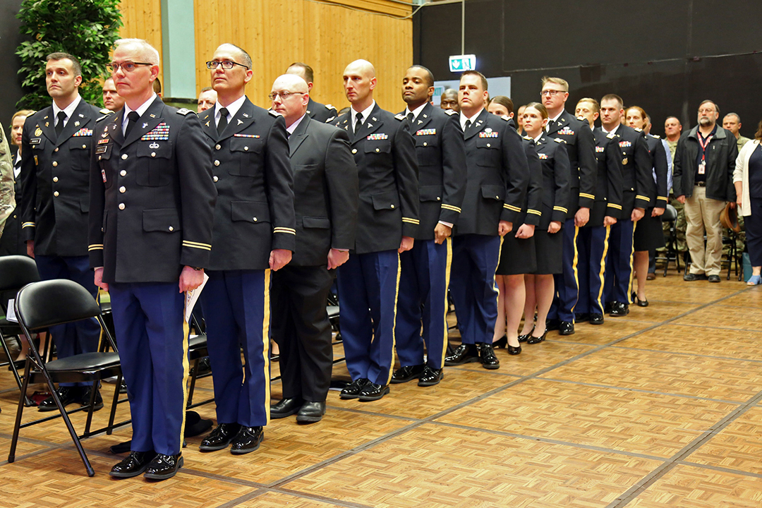 Intermediate Level Education (ILE) common core students stand at the start of a U.S. Army Command and General Staff Officers Course Common Core graduation ceremony hosted by the 7th ILE Detachment, 7th Mission Support Command, in Grafenwoehr, Germany, May 17, 2019. The 7th ILE DET offers a unique year-long ILE common core curriculum designed for multi-component officers deployed or stationed overseas. (Photo by Sgt. 1st Class Joy Dulen)