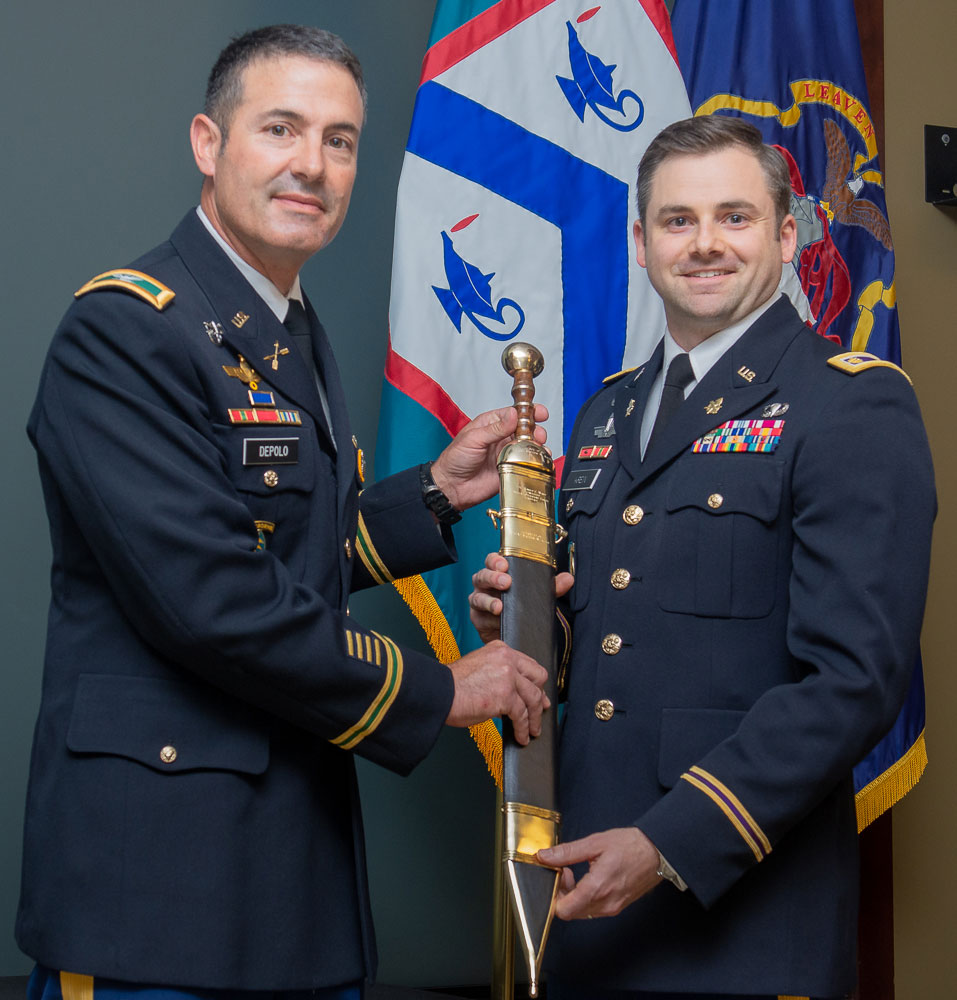 Maj. Matthew W. Krein receives the Roman Gladius sword, signifying his selection as the LTC Ronald C. Ward Distinguished Special Operations Forces Student Award for the Command and General Staff Officer Course Class of 2019 in a ceremony June 12 in the Arnold Conference Room of the Lewis and Clark Center. Col. James M. Depolo, the director for Special Operations at the U.S. Army Combined Arms Center/Fort Leavenworth presents the award. (photo by Dan Neal/ArmyU Public Affairs)