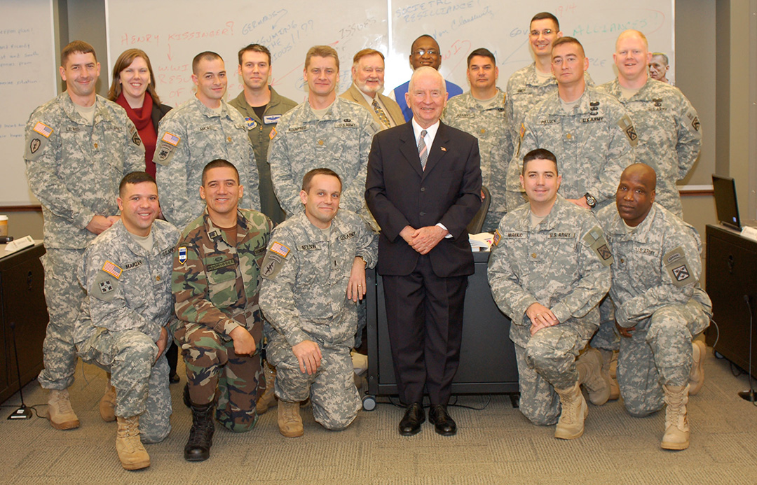 Ross Perot takes a group photo after participating in class discussion with CGSC Professor Bud Meador and his students during his visit to the College Oct. 20, 2009.