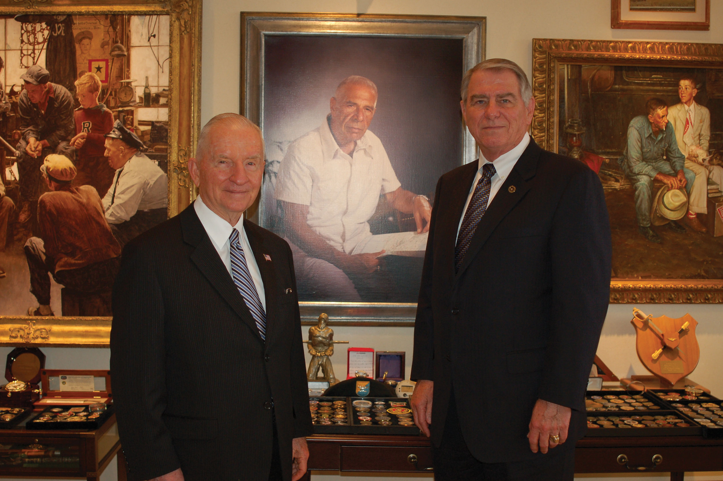 """H. Ross Perot, left, and CGSC Foundation CEO Bob Ulin stand in front of a portrait of Col. Arthur D. """"Bull"""" Simons in Perot's office in Plano, Texas, during a visit in January 2010."""