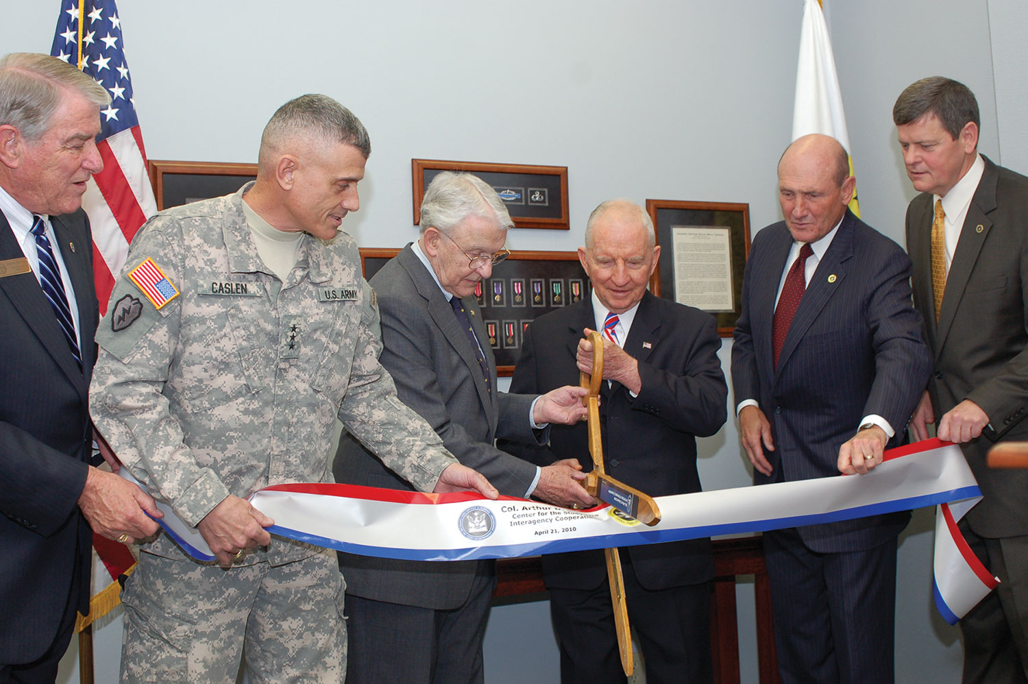 From left, Foundation CEO Bob Ulin, Fort Leavenworth Commander/CGSC Commandant Lt. Gen. Robert L. Caslen, Jr., Foundation Chairman Lt. Gen. (Ret.) Robert Arter, Ross Perot, Foundation President Hyrum Smith, and the Chief Operating Officer of the Simons Center, Maj. Gen. (Ret.) Ray Barrett, cut the ribbon for the opening of the Col. Arthur D. Simons Center for the Study of Interagency Cooperation, April 21, 2010. (photo by Mark H. Wiggins)
