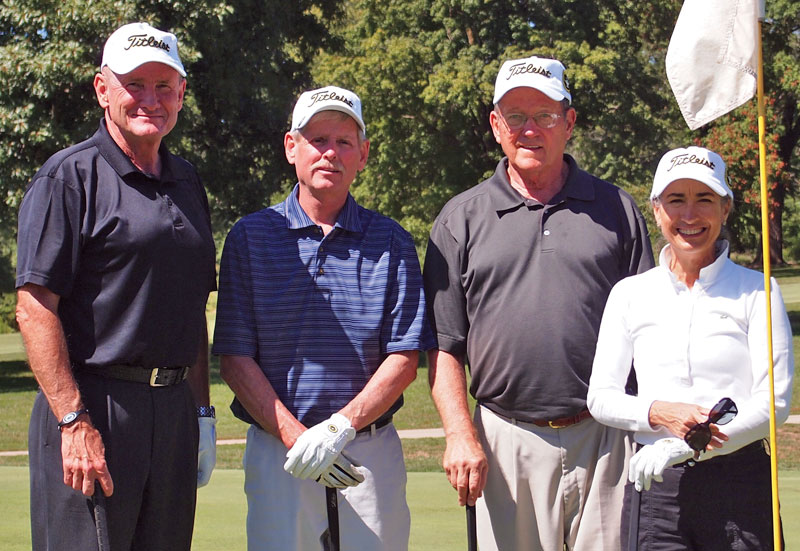 Hyrum Smith takes a photo with members of his team during the CGSC Foundation golf tournament on Sept. 6, 20011. Foundation trustee and Medal of Honor recipient Col. (Ret.) Roger Donlon is second from right. (photo by Mark H. Wiggins)