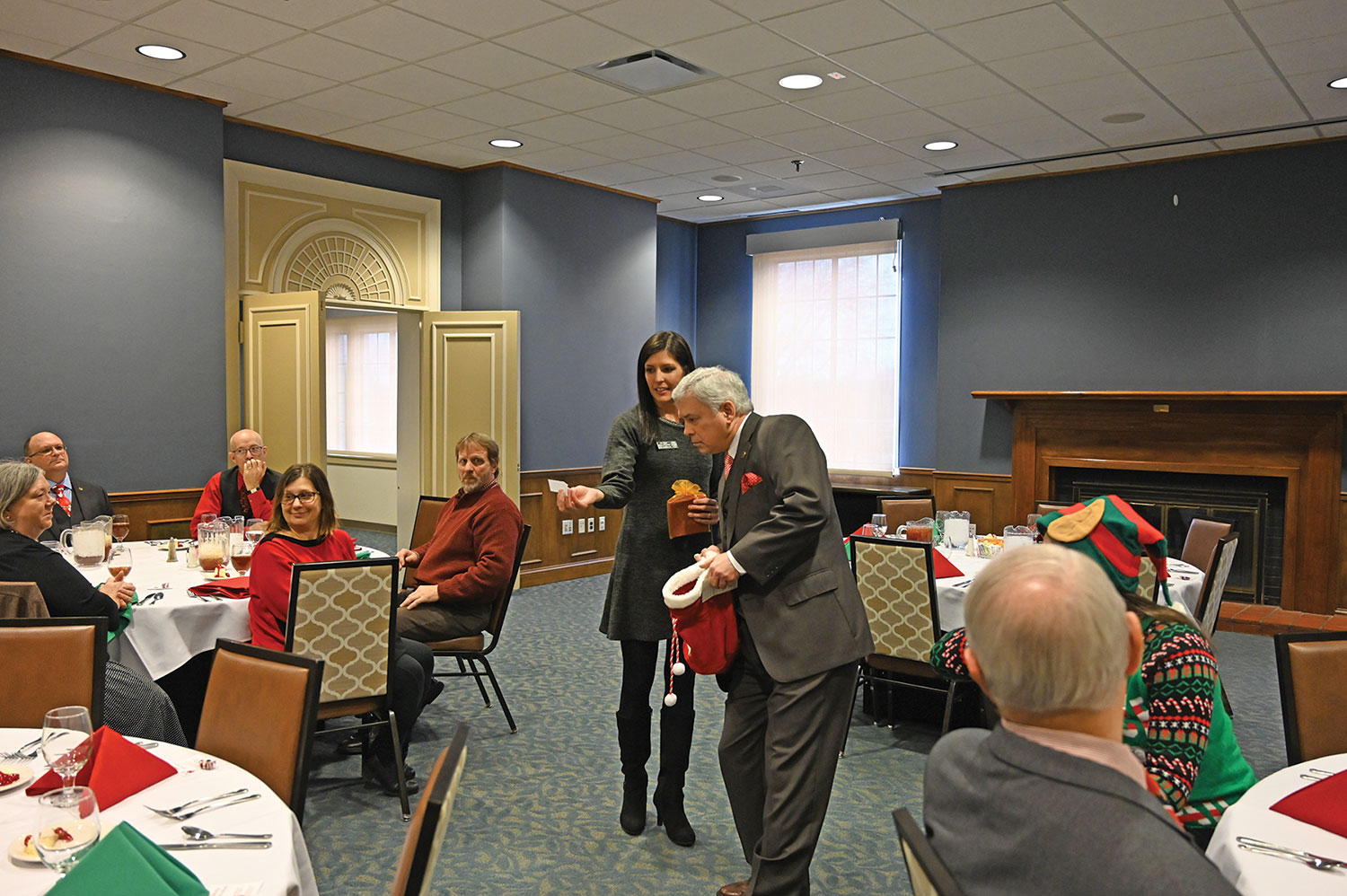 President/CEO Col. (Ret.) Rod Cox and Director of Operations Lora Morgan draw raffle tickets for Foundation holiday ornaments during the luncheon.