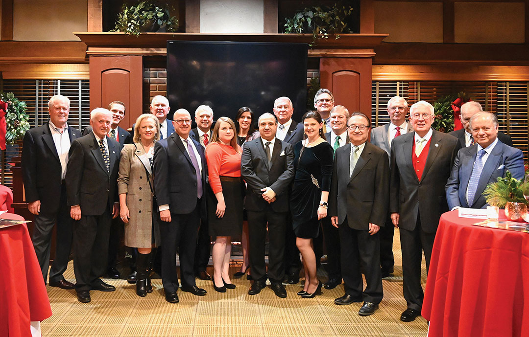 group photo of former and current Foundation trustees and staff at the major donor holiday reception on Dec. 17, 2019.