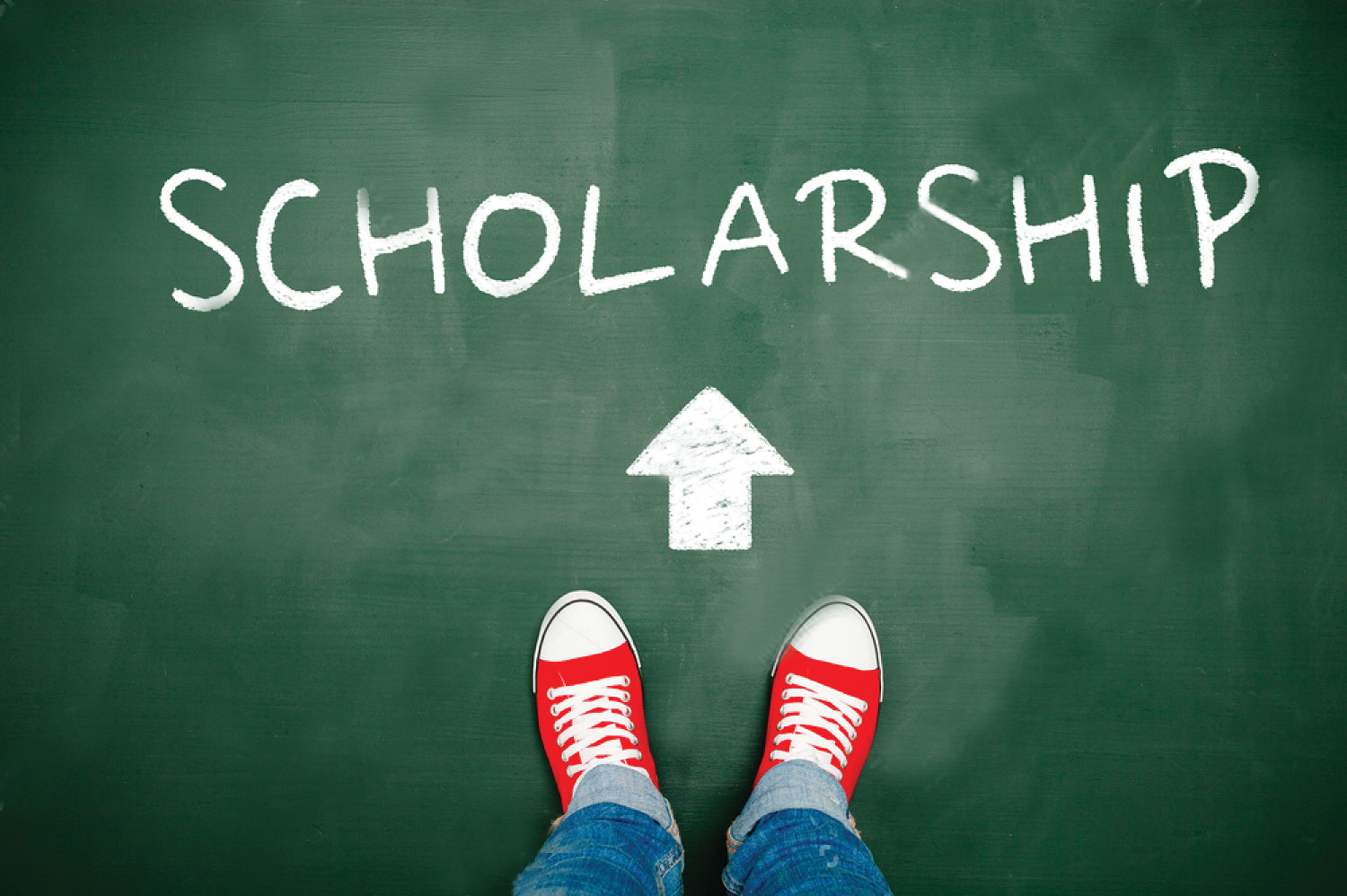 "image of person wearing sneakers standing behind an arrow pointing at the word ""scholarships"""