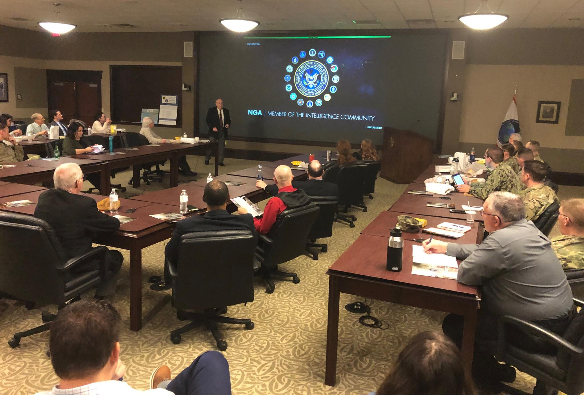 Mr. Ralph Erwin, Senior Intelligence Officer, speaks to students, faculty, and community members about the roles and missions of the National Geospatial-Intelligence Agency during the InterAgency Brown-Bag Lecture conducted Jan. 28, 2020, in the Lewis and Clark Center's Arnold Conference Room.