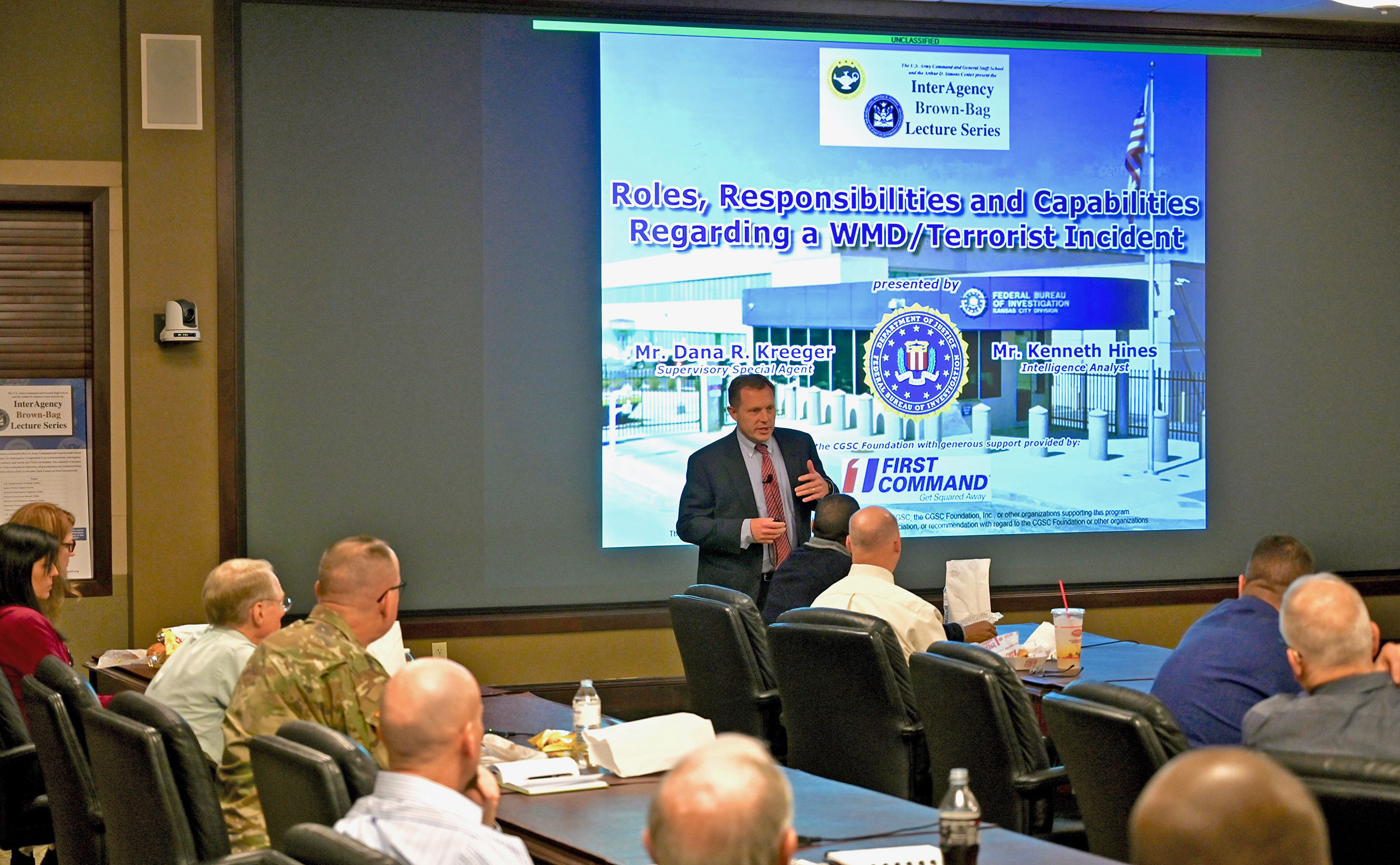 Supervisory Special Agent Dana Kreeger from the FBI's Kansas City Field Office kicks off the InterAgency Brown-Bag Lecture on Feb. 25, 2020, in the Arnold Conference Room of the Lewis and Clark Center.