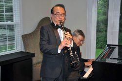 Benny Lee plays his clarinet at one of many receptions he has hosted for the CGSC Foundation.