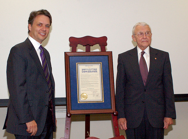 "Lt. Gov. Jeff Colyer, M.D., presents Foundation Chairman Lt. Gen. (Ret.) Robert Arter with a framed copy of Governor Sam Brownback's proclamation of Sept. 7, 2011, as ""CGSC Foundation Day."" Colyer was the guest speaker for the Foundation's annual meeting that day. (Photo by Mark Wiggins)"