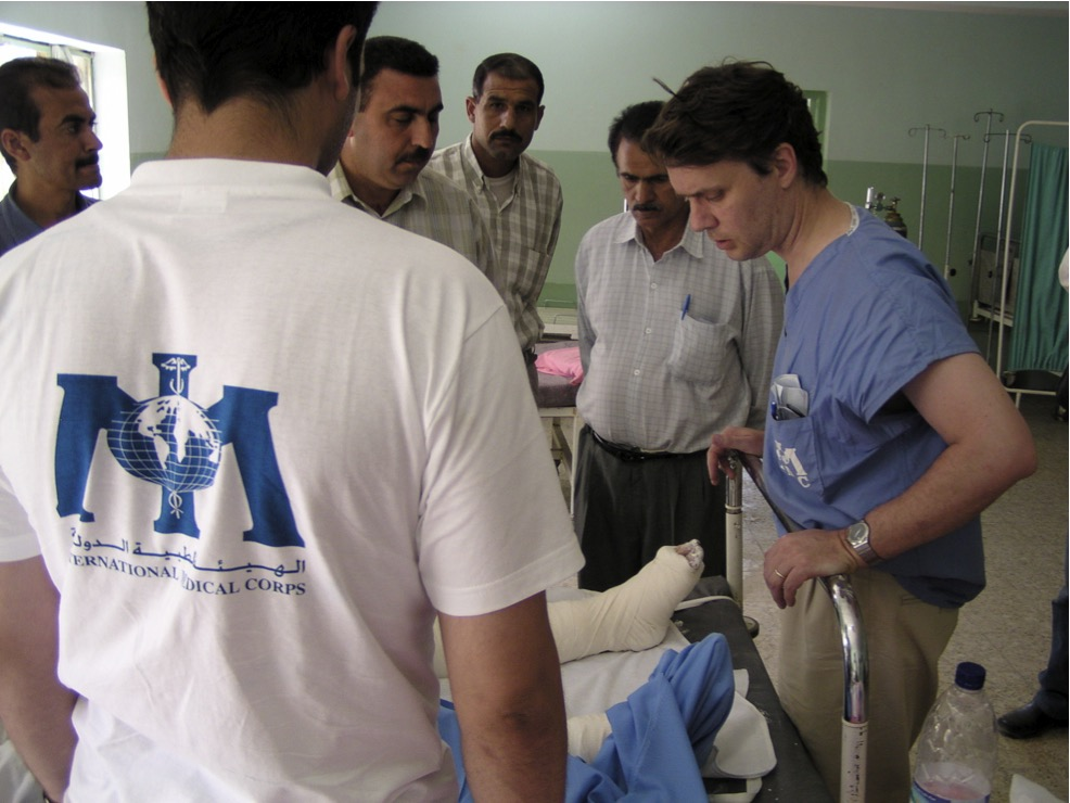 Dr. Jeff Colyer, right, assesses a patient's condition in a hospital in An Nasiriyah, Iraq, in 2003. Colyer, an Overland Park surgeon and an International Medical Corps volunteer, spent six weeks (April-May 2003) in Iraq helping doctors and hospitals assess and react to the crises during the U.S.-led invasion of the country that began in March 2003.