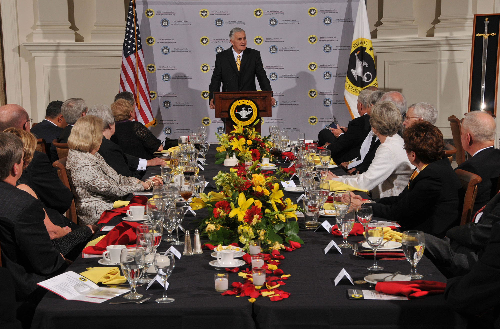 "Gen. Hugh Shelton speaks to the guests after receiving the CGSC Foundation's 2011 Distinguished Leadership Award. Seen at right is the replica ""Excaliber"" sword, a personal gift to Shelton from Mr. Ross Perot in honor of the occasion."