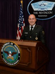 Maj. Vegim Krelani with the regular army from Pristina, Kosovo, poses for a photo in the Pentagon briefing room during a visit there. Krelani is attending the Command and General Staff Officers Course in Germany hosted by the 7th ILE Detachment from July 2020 through July 2021.