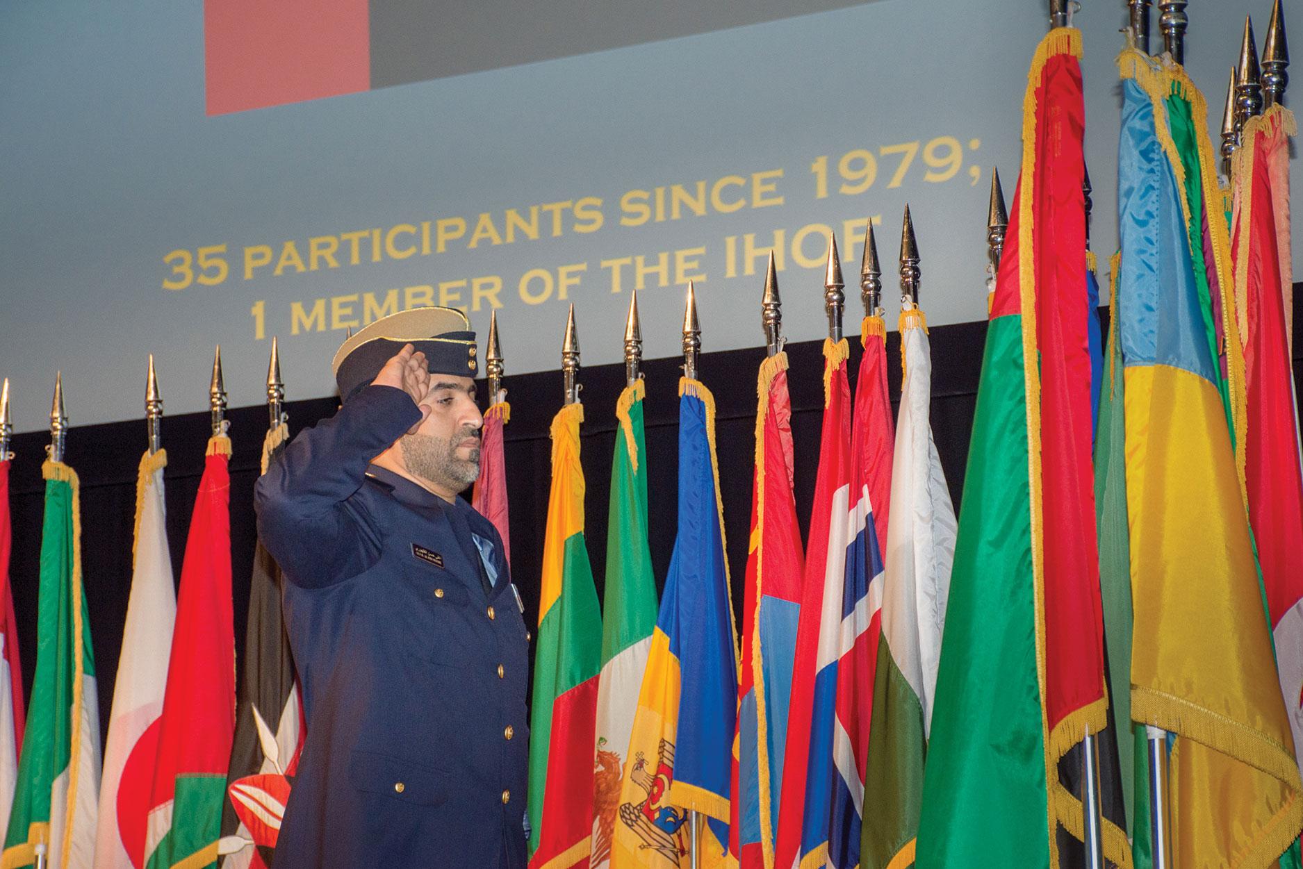 Maj. Ali Alduhuhoori, United Arab Emirates, renders honors to his national colors during the International Military Student Flag Ceremony on Sept. 8.