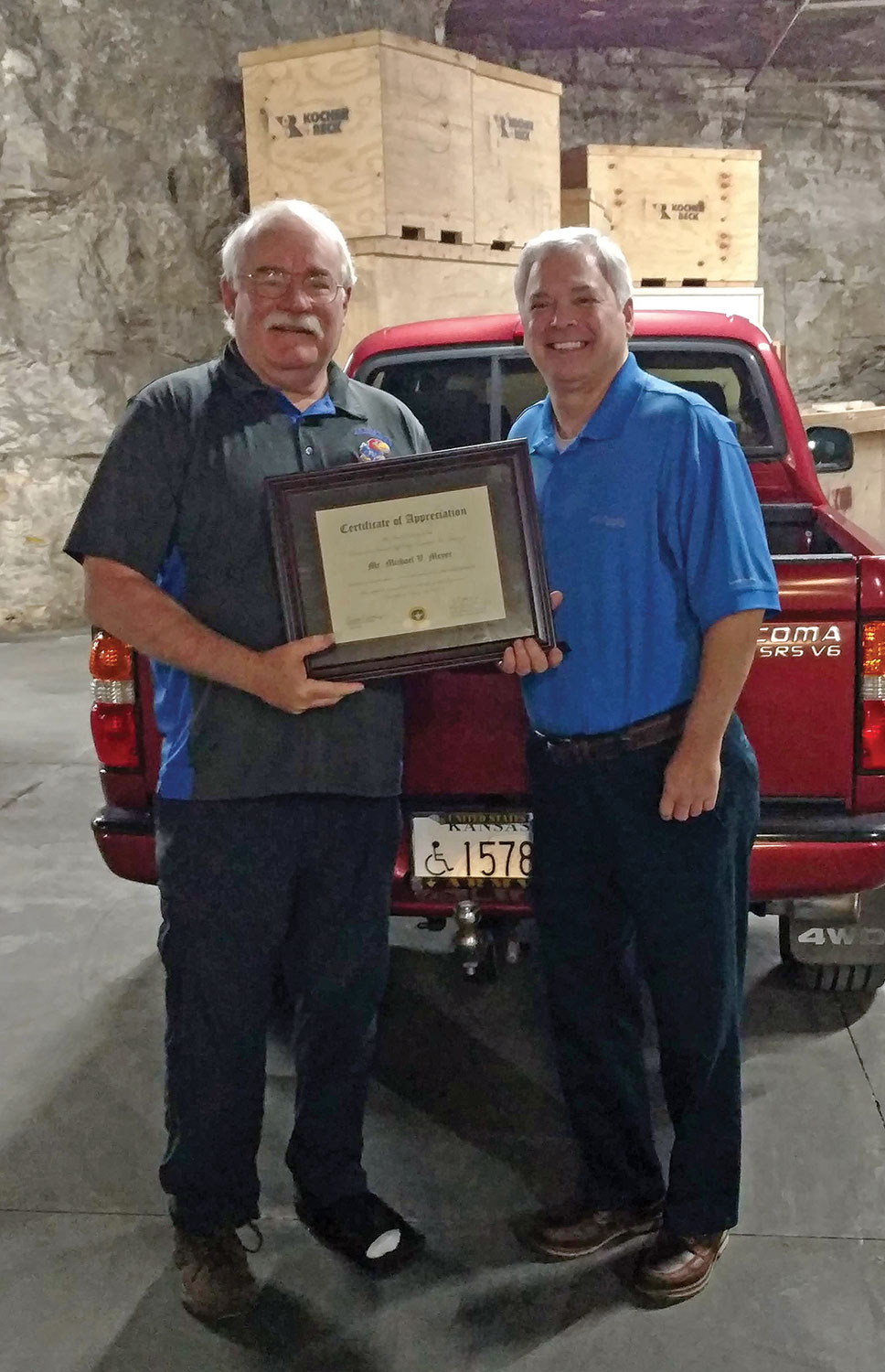 Foundation CEO Rod Cox presents Mike Meyer with a certificate of appreciation for his service as a Foundation trustee from August 2011 to August 2020.