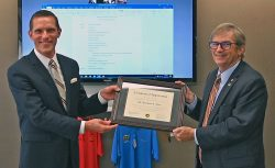 Foundation Chair Mike Hockley, right, presents a certificate of appreciation to long serving trustee and Foundation Treasurer Doug Adair during the August 2020 Foundation board meeting.