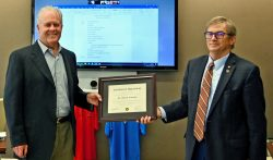 Foundation Chair Mike Hockley, right, presents a certificate of appreciation to long serving trustee and Foundation 1st Vice Chair John Robinson during the August 2020 Foundation board meeting.