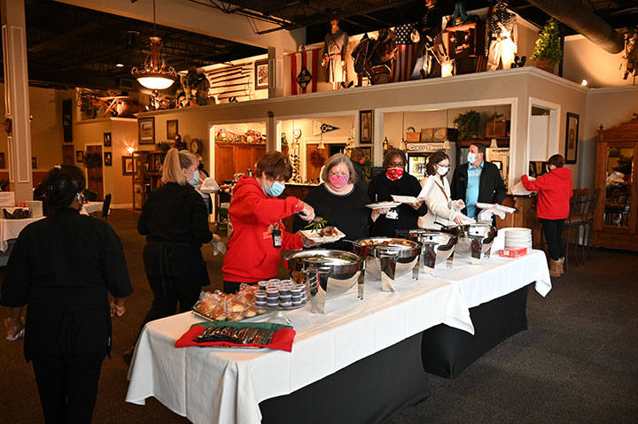 Guests go through the buffet line at the CGSC Foundation's annual holiday appreciation luncheon at June's Northland in Leavenworth, Kansas on Dec. 11, 2020.