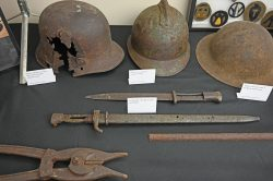 photo of WWI helmets, bayonets and wire cutters in the CGSC Foundation gift shop.