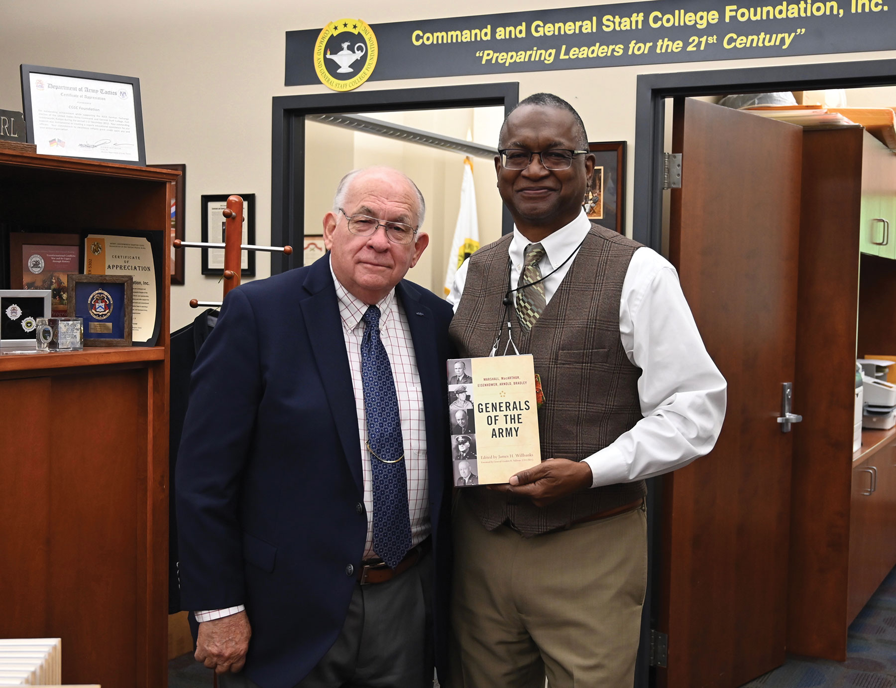 """CGSC Professor Dwayne Wagner reunites with Dr. James H. Willbanks, editor of 'Generals of the Army,"""" and former director of CGSC's Department of Military History, during the book signing in the CGSC Foundation gift shop on May 13, 2021."""