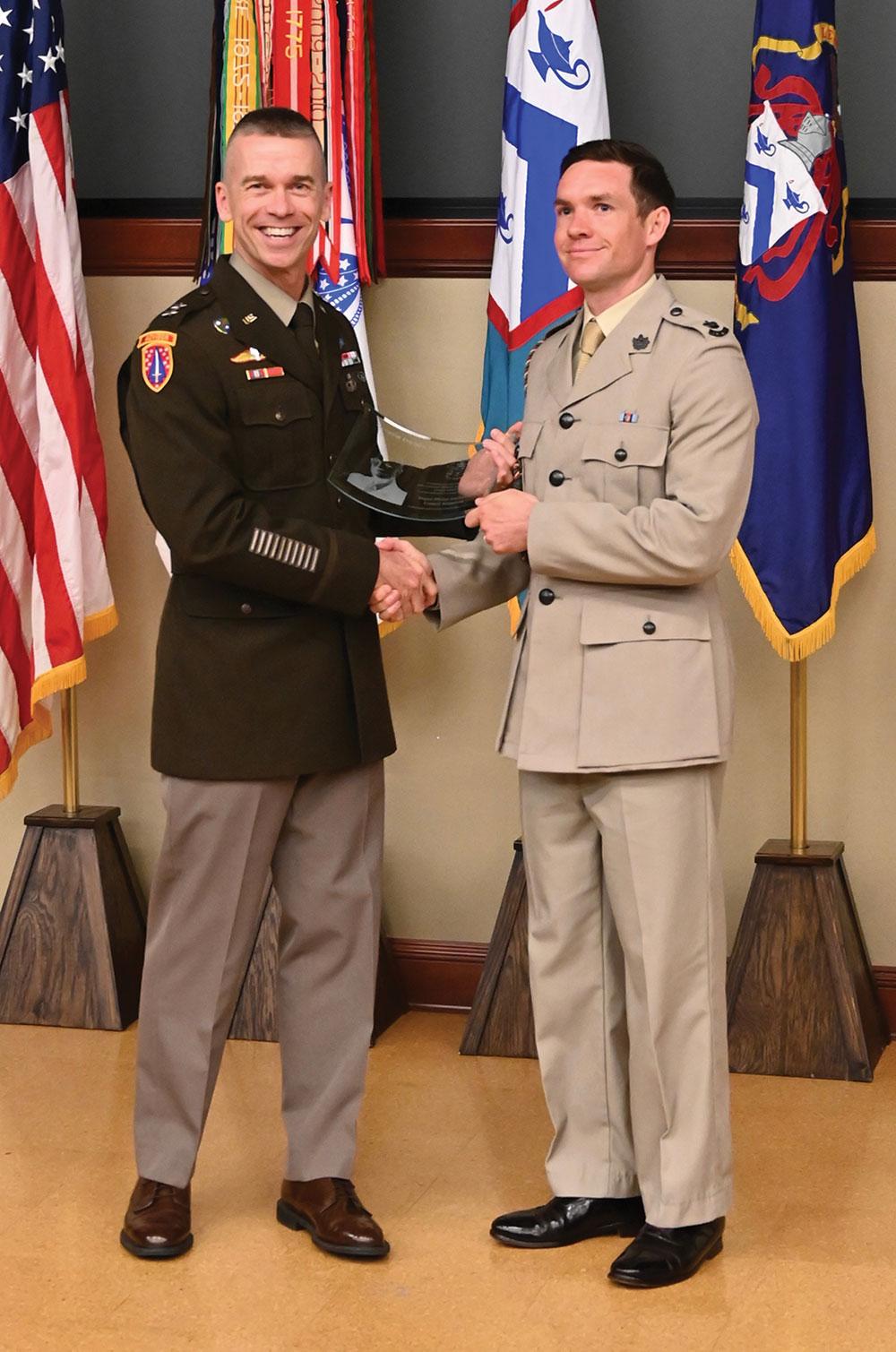 CGSC Deputy Commandant Maj. Gen. Donn Hill presents the Eisenhower Award to Maj. Philip Anderson, International Military Student, United Kingdom.