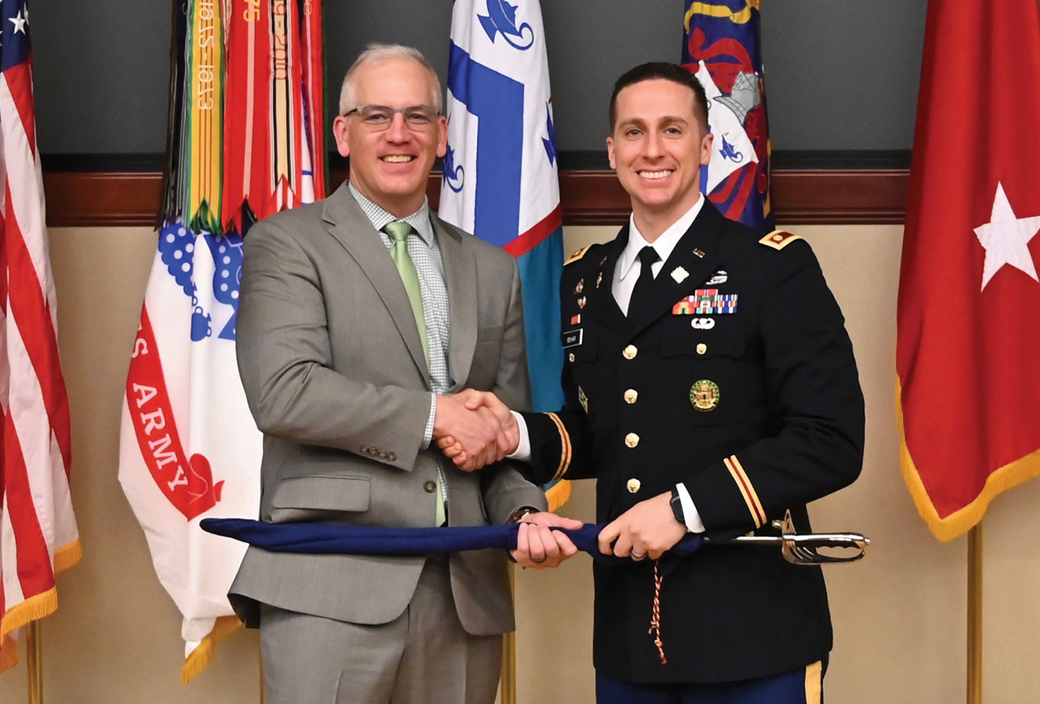 Department of Sustainment and Force Management (DSFM) Deputy Director Paul Schlimm presents the General James M. Wright Master Logistician Award to Maj. Avraham Behar.