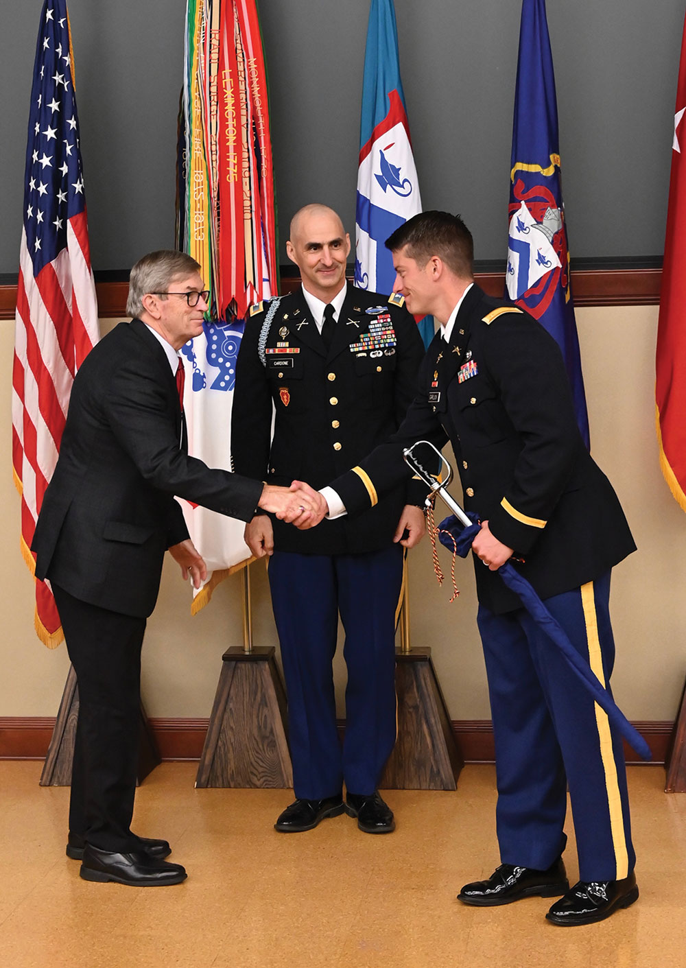 CGSC Foundation Chairman Mike Hockley and Department of Army Tactics Director Col. Chris Cardone present the General George S. Patton Jr. Master Tactician Award to Maj. Christopher Garlick.