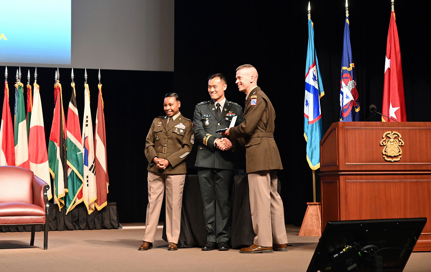Maj. Gen. Donn H. Hill, Deputy Commandant of the Command and General Staff College, Provost-Army University, and Deputy Commanding General-Education for the Combined Arms Center, and Command and Command Sgt. Maj. Faith Alexander, Senior Enlisted Advisor to the Provost, presented the graduation badges to the graduating international officers of the CGSC Class of 2021 on June 17, 2021.
