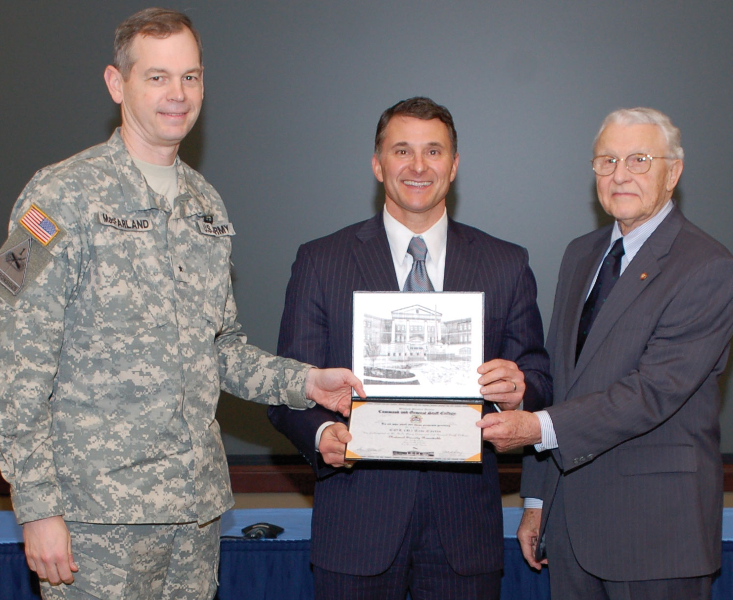 Tim Carlin receives his CGSC Foundation National Security Roundtable certificate on April 26, 2011 from then CGSC Deputy Commandant Brig. Gen. Sean MacFarland, left, and retired Lt. Gen. Robert Arter, then chairman of the CGSC Foundation, right. The next year Carlin would accept a nomination to serve on the Foundation board of trustees.