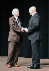 CGSC Foundation President/CEO Roderick M. Cox presents Lt. Gen. (Ret.) H.R. McMaster with a commemorative Colin L. Powell coin in appreciation of his presentation as the Colin. L. Powell Lecture Series speaker for Academic Year 2022.
