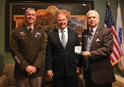 CGSC Deputy Commandant Brig. Gen. Donn Hill, left, joins Lt. Gen. (Ret.) H.R. McMaster, and CGSC Foundation President/CEO Roderick M. Cox in the green room after McMaster's lecture in Eisenhower Hall on Sept. 8, 2021.