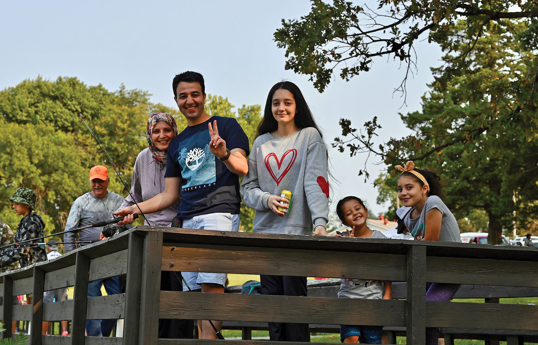 Lt. Col. Ahmed Etman along with his wife and three daughters fish from the dock at Merritt Lake, Fort Leavenworth, during the International Family Fishing Derby on Sept. 11. Etman is an international military student from Egypt enrolled in the Command and General Staff Officers Course Class of 2022.