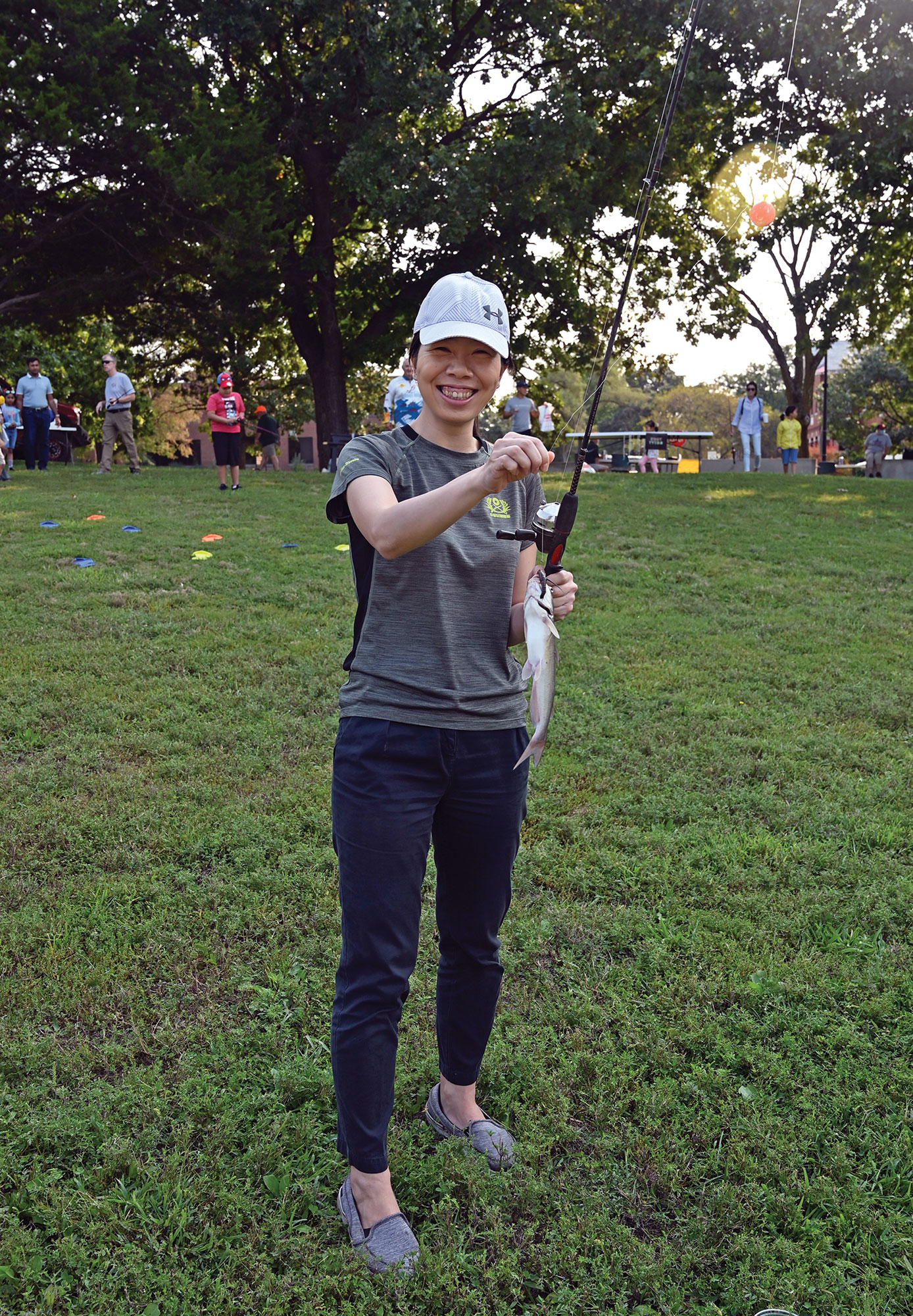 Maj. Yu-yung Chiu, a Taiwanese army officer enrolled in the Command and General Staff Officers Course Class of 2022, shows off the catfish she reeled in during the International Family Fishing Derby Sept. 11 at Merritt Lake.