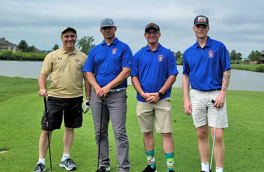 CGSC Foundation Trustee Pat Proctor, the Kansas State Representative for the 41st District, takes a group photo at the golf tournament with (from left) Sgt. 1st Class Rivera from 15th Military Police Brigade, Fort Leavenworth NCO of the year Sgt. Andrew Hamer, and Fort Leavenworth Soldier of the year Pfc. Jason Geise.