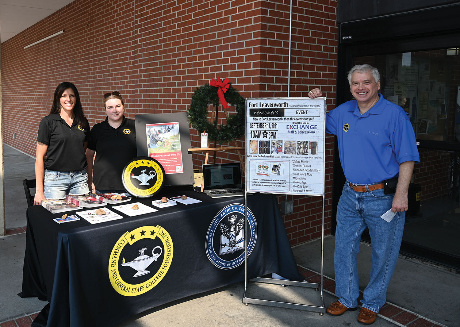 The CGSC Foundation set up a Wreaths Across America booth at the Fort Leavenworth Post Exchange on Sept. 11, 2021 to increase awareness of wreath sponsorships. From left, Lora Morgan, director of operations, Elizabeth Hill, program assistant, and Rod Cox, president/CEO.